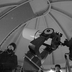 BAS members in the observatory dome, by Peter Truscott